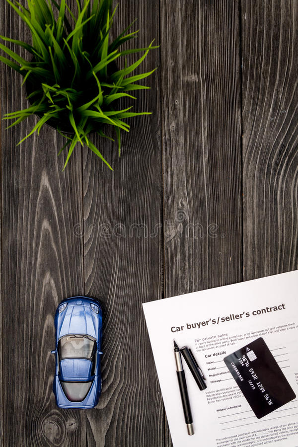 Concept of buying car on dark wooden background top view.  stock photos