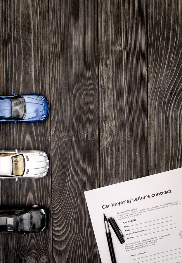 Concept of buying car on dark wooden background top view.  royalty free stock photo