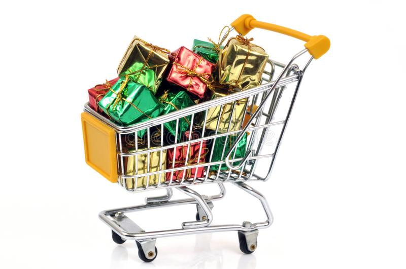Supermarket trolley filled with gifts royalty free stock photography