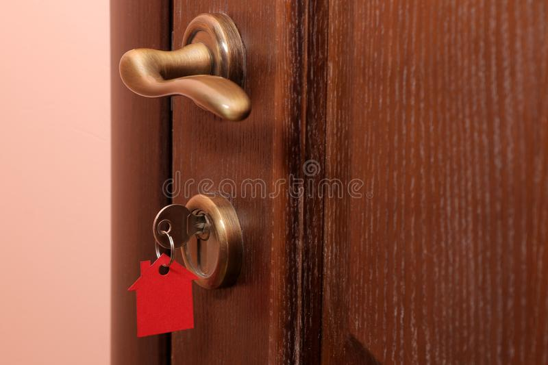 The concept of buying a home. Keys with keychain house in the door lock close-up royalty free stock photos