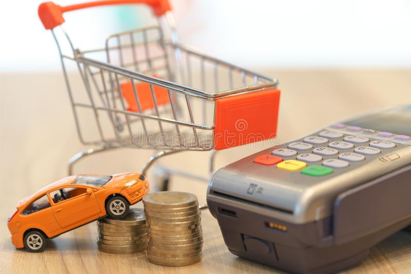 Concept of buying new car by money with red shopping cart and ma stock photography