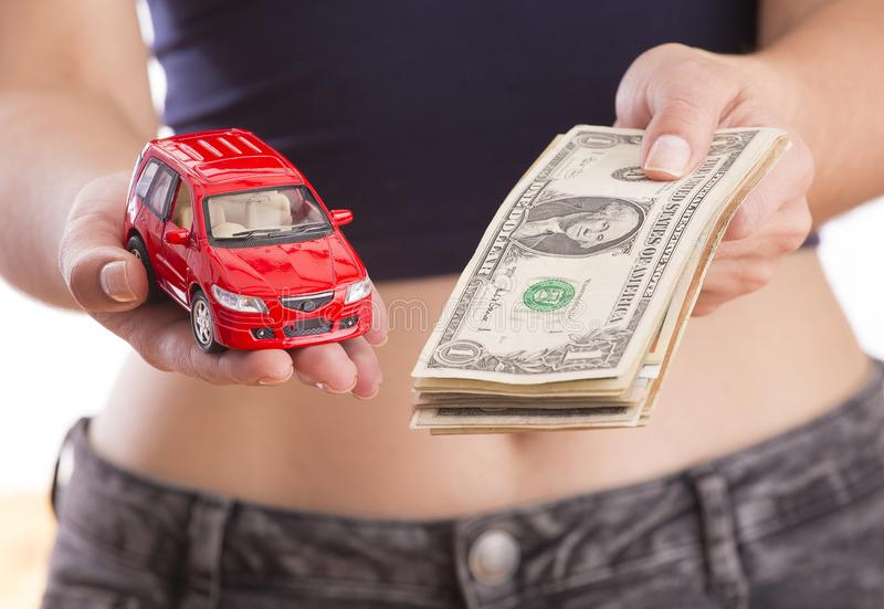 Woman with car and money - buying and selling. Concept of buying and selling car royalty free stock image