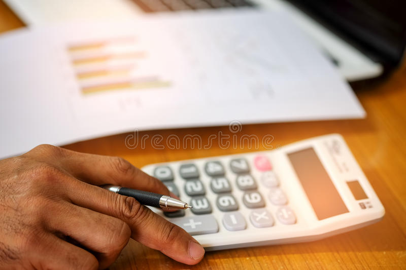 Concept,Calculate income and expenses. royalty free stock image
