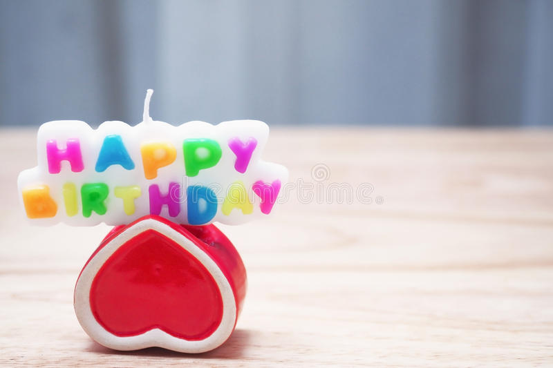 Concept candles text happy birth day. And red heart on wood copy space royalty free stock images