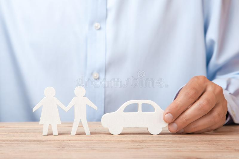 The concept of car rental, credit or insurance. Man in shirt is holding car and family royalty free stock images