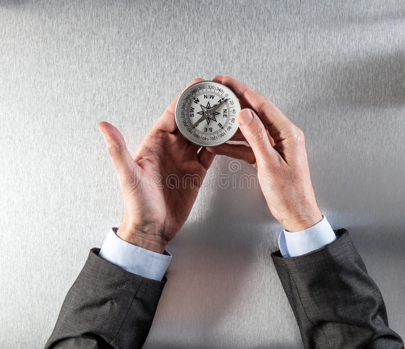 Concept of career exploration for businessman hands holding a compass royalty free stock photo