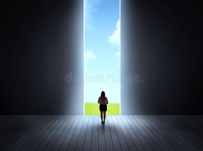 Businessman walking to open gate. Concept of career and freedom of nature with a bright open gate stock image