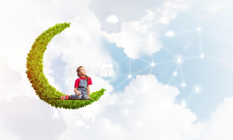 Concept of careless happy childhood with girl dreaming about something stock image