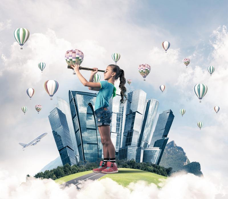 Concept of careless happy childhood with girl looking in future royalty free stock photo