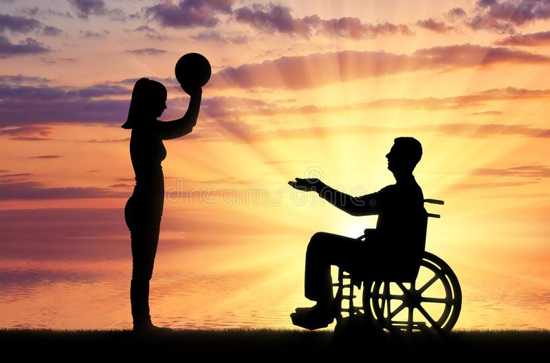 Concept of caring and supporting disabled people in the family. Silhouette of a disabled man in a wheelchair and his wife playing together by the sea. The royalty free stock photo