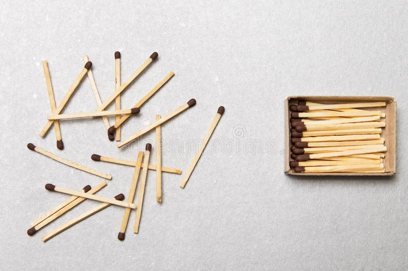 The concept of chaos and order. Chaotic match boxes lying around with the order of stacked matches. stock photos