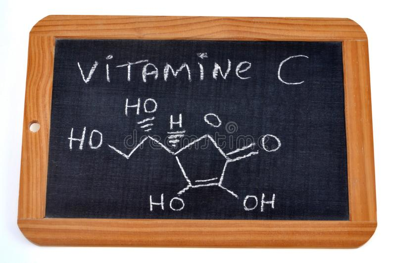 Chemical Formula of Vitamin C in French on a School Slate royalty free stock photos