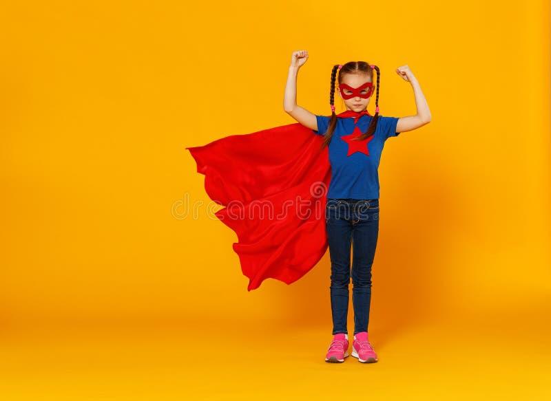 Concept of child superhero costume on yellow background royalty free stock photo