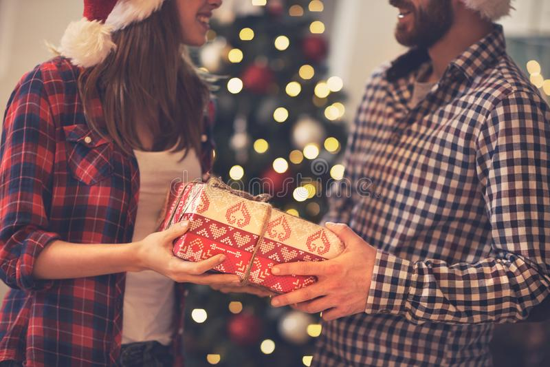 Concept Christmas present in hands stock images