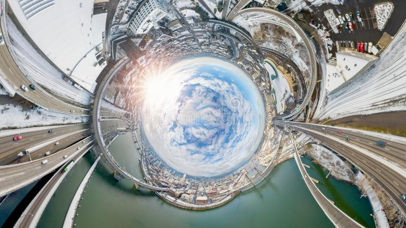 Concept City for Space. An image converted from the 360 by 180 aerial view of city highway and snowy railroad royalty free stock photography