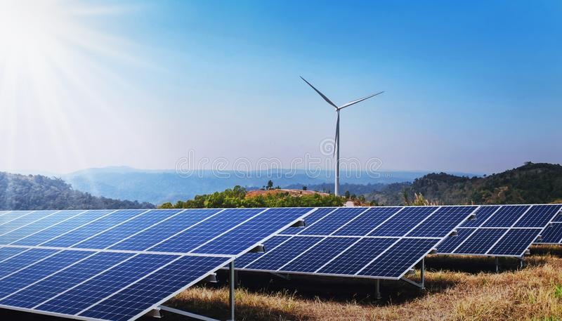 Concept clean energy power in nature. solar panel and wind turbine on hill. With sunshine royalty free stock photo