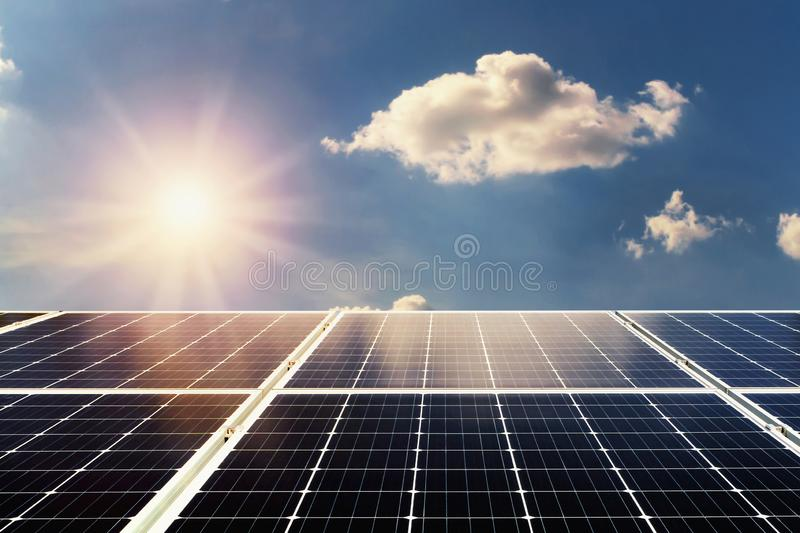 concept clean power energy. solar panel and sunlight with blue s royalty free stock photography