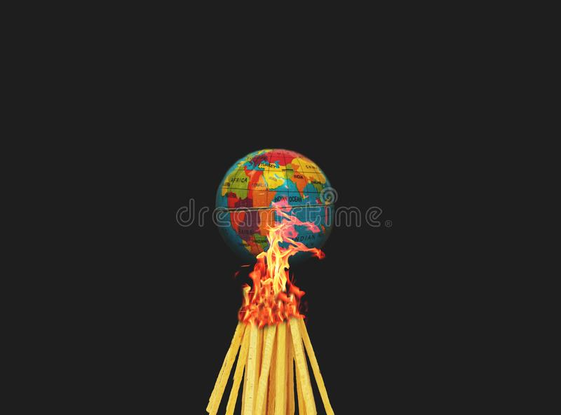 Concept of Climate change or Global warming showing with burning the globe or earth on black background stock photo