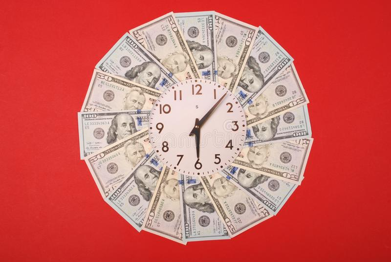 Concept of clock and dollar. Clock on mandala kaleidoscope from money. Abstract money background raster pattern repeat mandala stock photo