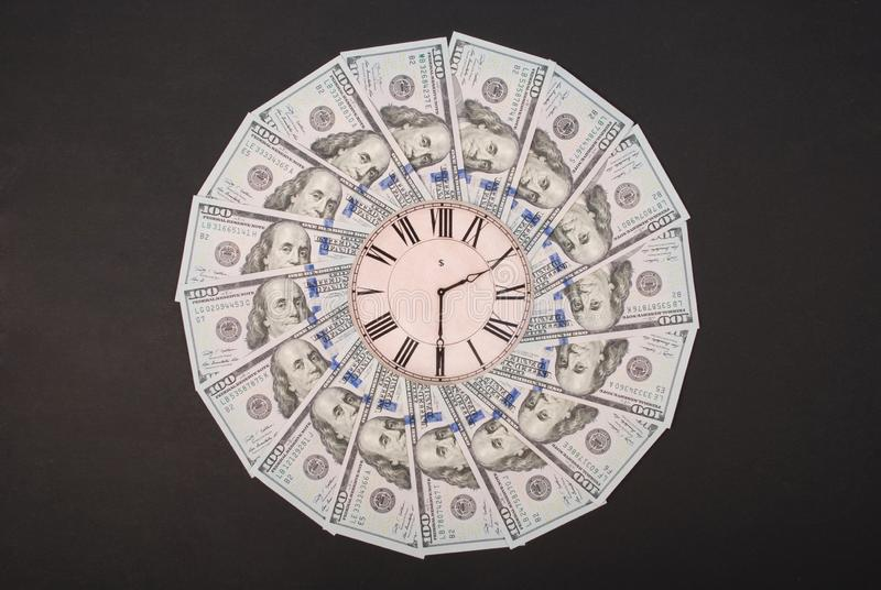 Concept of clock and dollar. Clock on mandala kaleidoscope from money. Abstract money background raster pattern repeat mandala royalty free stock image