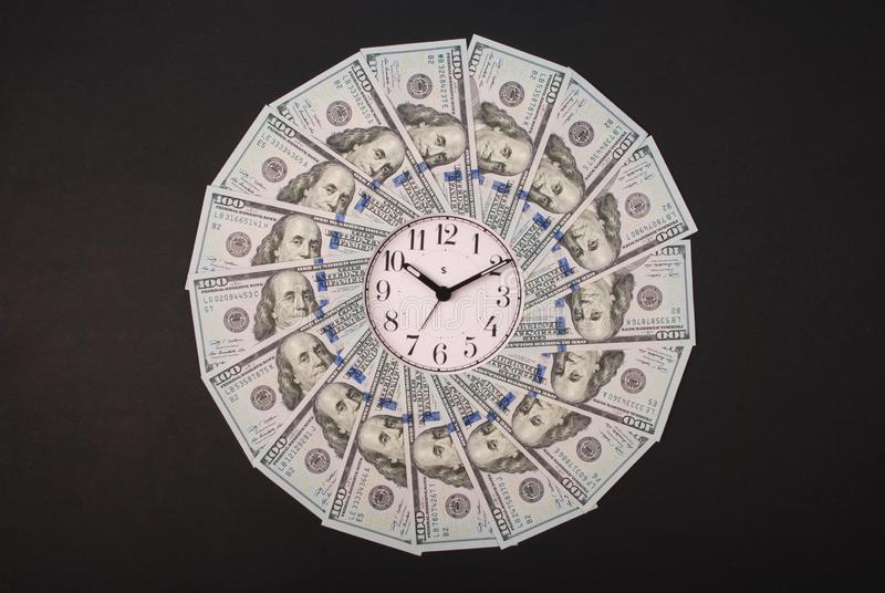 Concept of clock and dollar. Clock on mandala kaleidoscope from money. Abstract money background raster pattern repeat mandala stock images