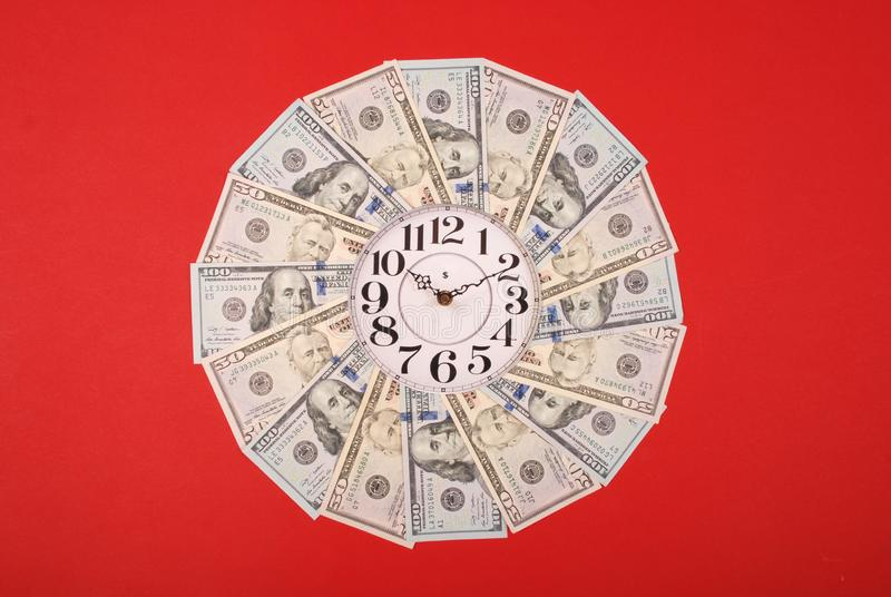 Concept of clock and dollar. Clock on mandala kaleidoscope from money. Abstract money background raster pattern repeat mandala. Circle. On red background royalty free stock photos
