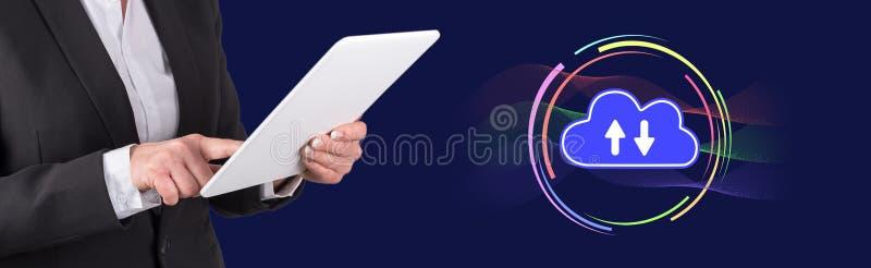 Concept of cloud computing. Woman using digital tablet with cloud computing concept on background stock photo