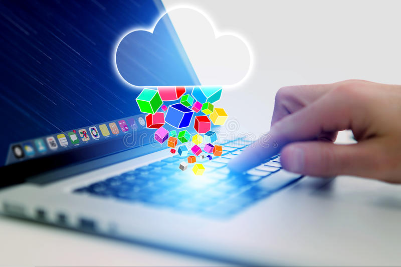 Concept of cloud storage icon flying out a computer - technology. Concept stock photos