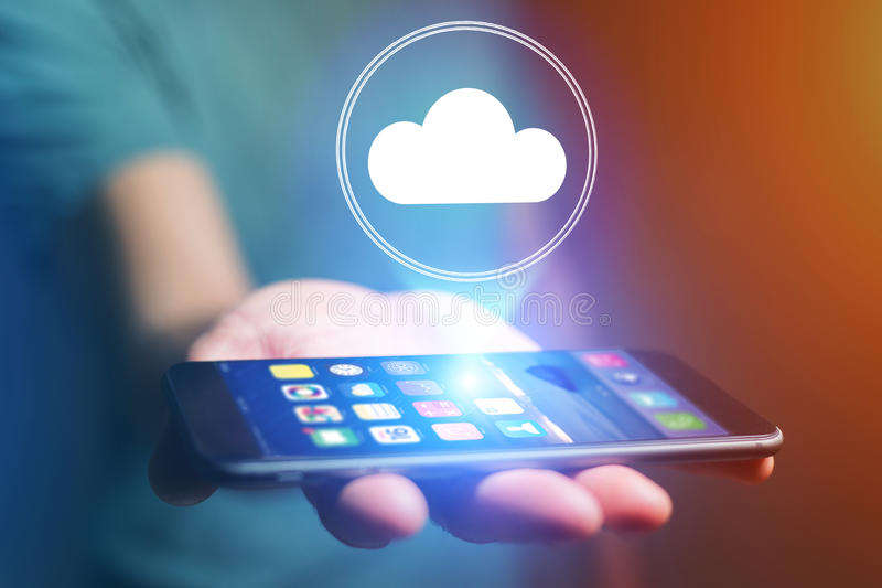 Concept of cloud storage icon flying out a smartphone - technology concept. Concept view of cloud storage icon flying out a smartphone - technology concept stock photos