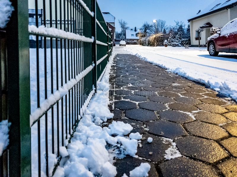 Concept of cobblestone pavement cleared from the snow.  stock images