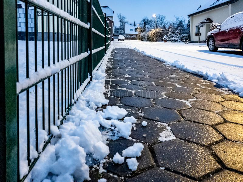 Concept of cobblestone pavement cleared from the snow.  stock photography