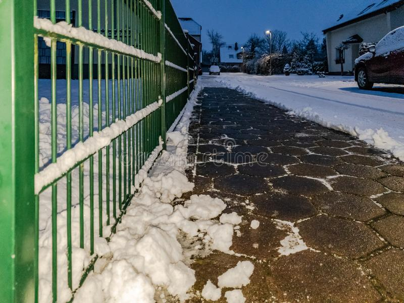 Concept of cobblestone pavement cleared from the snow.  royalty free stock photo