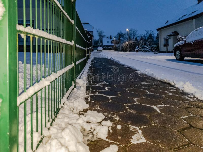 Concept of cobblestone pavement cleared from the snow.  stock photo