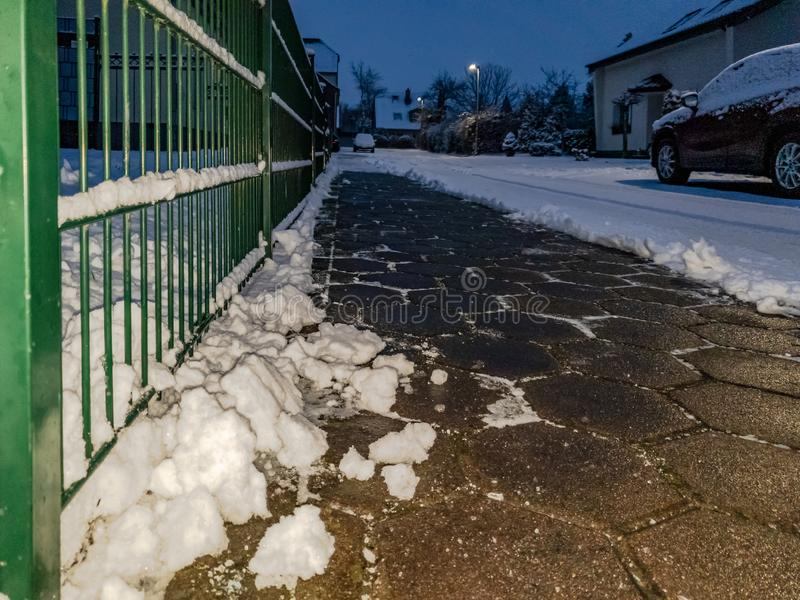 Concept of cobblestone pavement cleared from the snow.  royalty free stock images