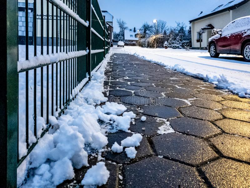 Concept of cobblestone pavement cleared from the snow.  stock photos