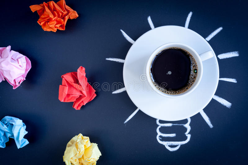 Concept coffee awakens brain on dark background top view.  stock photography