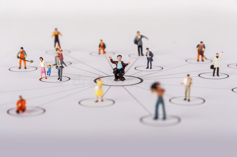 The concept of a collective solution to any problem. Miniature toy workers. royalty free stock photos