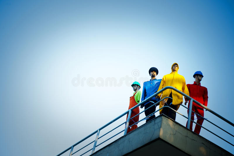 Concept coloré léger modèle de Workers Rooftop Day image stock