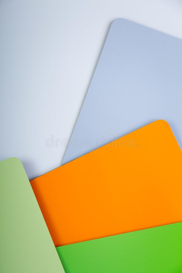 Concept of color cards on white background four colors green, lime, orange, gray isolate on white background stock image