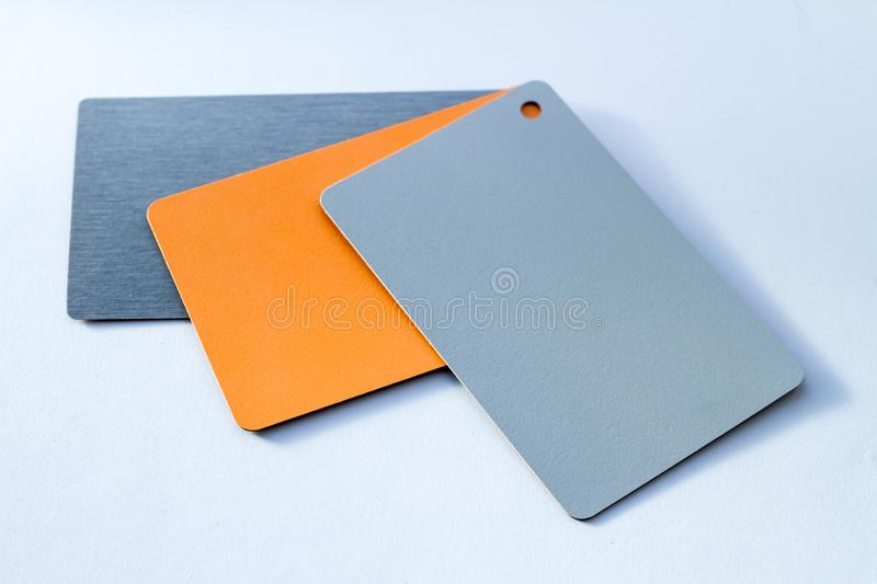 Concept of color cards on white background three colors grayscale and orange isolate on white background stock image