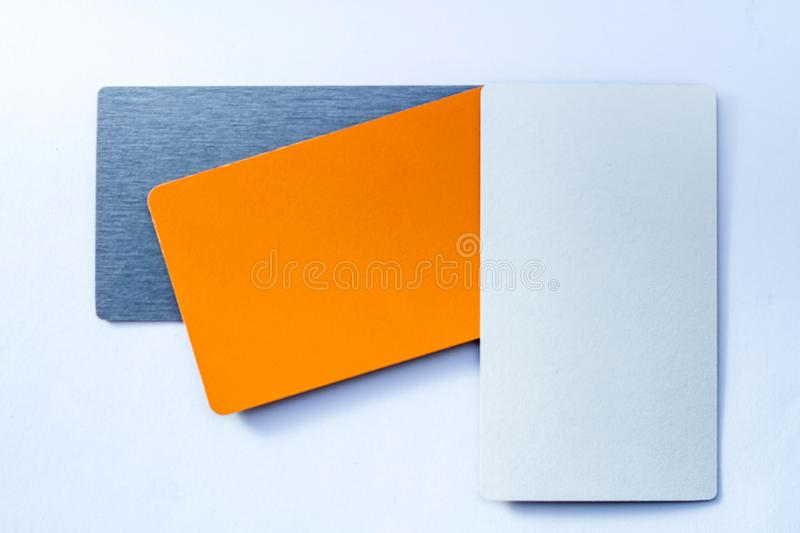 Concept of color cards on white background three colors grayscale and orange isolate on white background stock photography