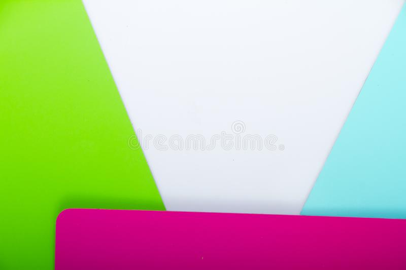 Concept of color cards on white background three colors pink, green, blue isolate on white background stock photography