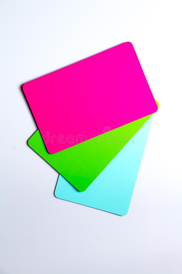 Concept of color cards on white background three colors pink, green, blue isolate on white background stock photos