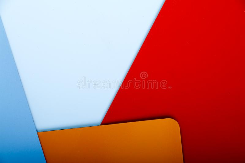 Concept of color cards on white background three colors red, orange, blue isolate on white background stock image