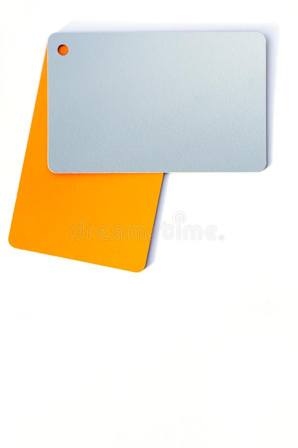 Concept of color cards on white background two colors gray and orange isolate on white background stock photography