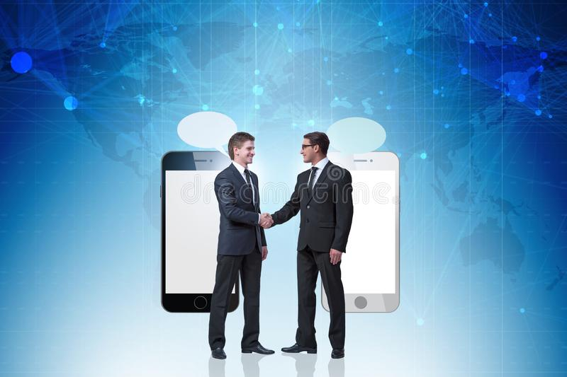 Concept of communication with businessmen handshaking royalty free stock photo