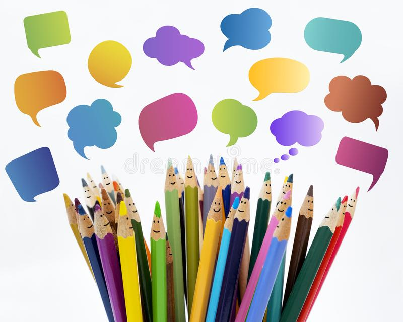Social network communication. Colored pencils funny faces of people smiling. Dialogue group of people. Crowd Talking. Group of peo royalty free stock photography