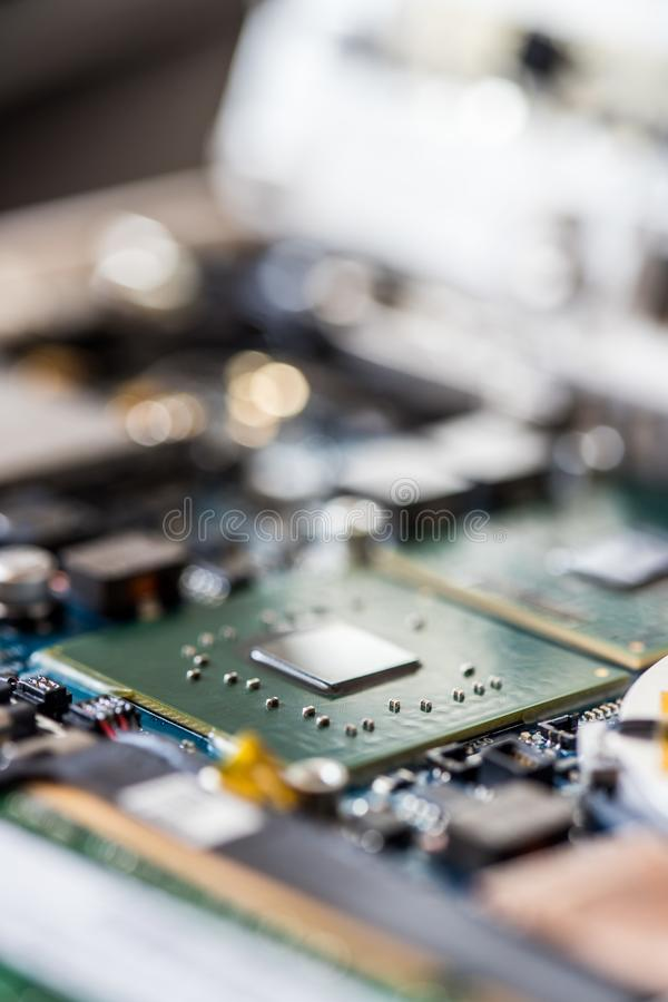 Concept of computer Technology: Close up of a computer chip on a circuit board. Computer chip on a circuit board, close up; Computer technology artificial stock images