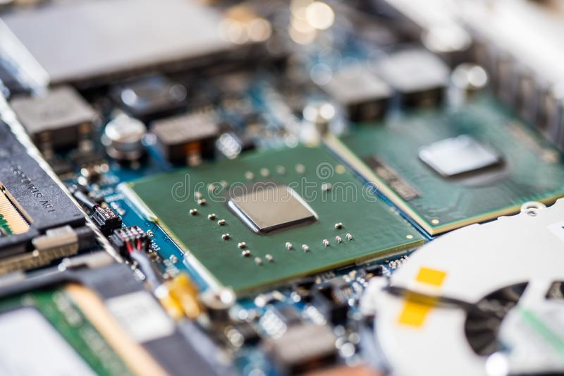 Concept of computer Technology: Close up of a computer chip on a circuit board. Computer chip on a circuit board, close up; Computer technology artificial royalty free stock images