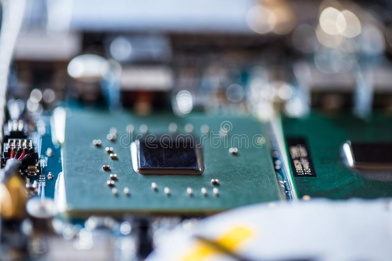 Concept of computer Technology: Close up of a computer chip on a circuit board. Computer chip on a circuit board, close up; Computer technology artificial royalty free stock image